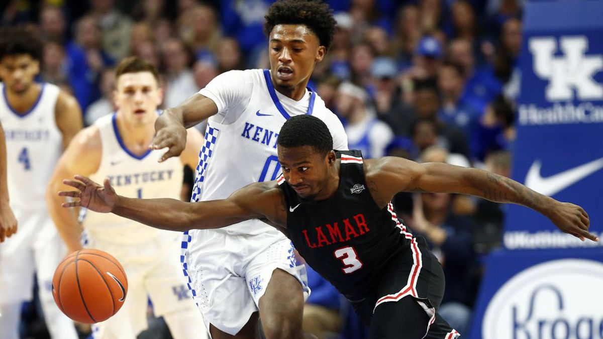 Lamar's Ellis Jefferson (3) struggles with the ball while pressured by Kentucky's Ashton Hagans (0) during the first half of an NCAA college basketball game in Lexington, Ky., Sunday, Nov. 24, 2019.