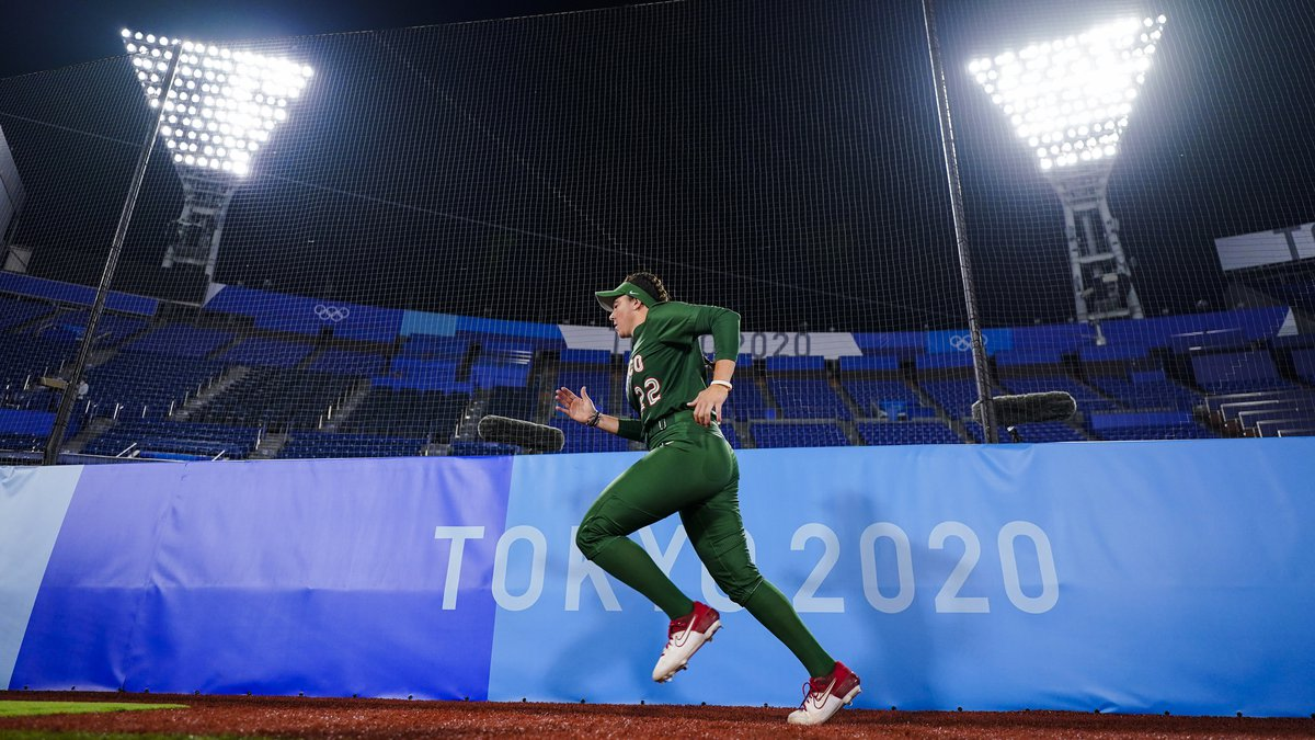 Mexico's Brittany Cervantes warms up before a softball game against Italy at the 2020 Summer...