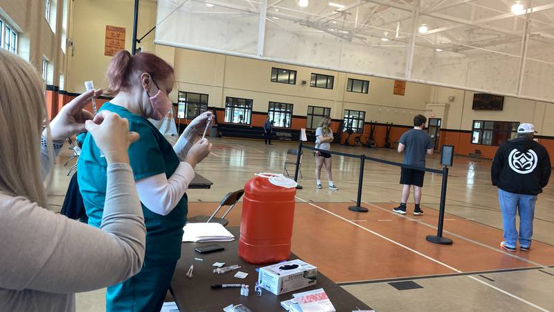 Georgetown College students lined up to get vaccinated and tested.
