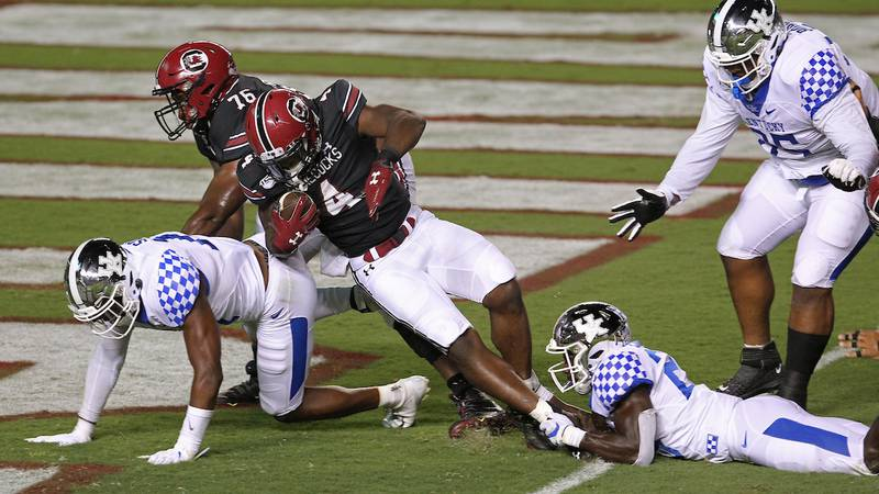 South Carolina running back Tavien Feaster (4) gets into the endzone for a touchdown against...
