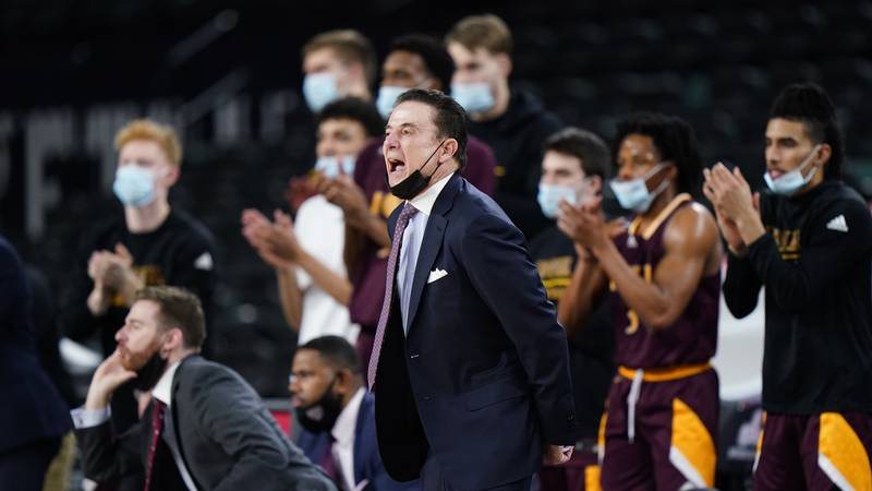 Iona head coach Rick Pitino yells to his team in the first half of an NCAA college basketball...