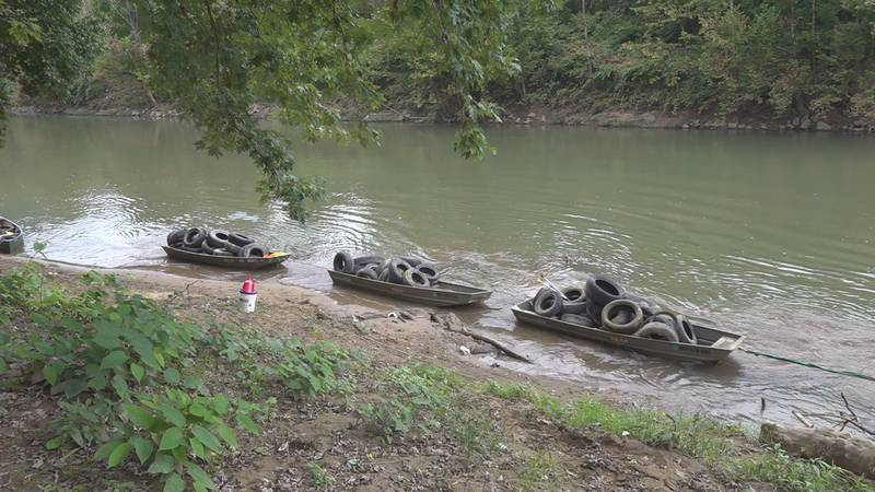 Organizers say the groups on hand Monday recovered around 500 tires from the Tug Fork River as...