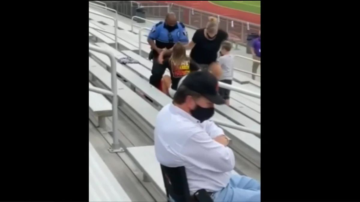Woman appears to refuse wearing a mask, is tased at football game in Logan, Ohio