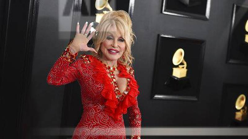 FILE - In this Feb. 10, 2019 file photo, Dolly Parton arrives at the 61st annual Grammy Awards...