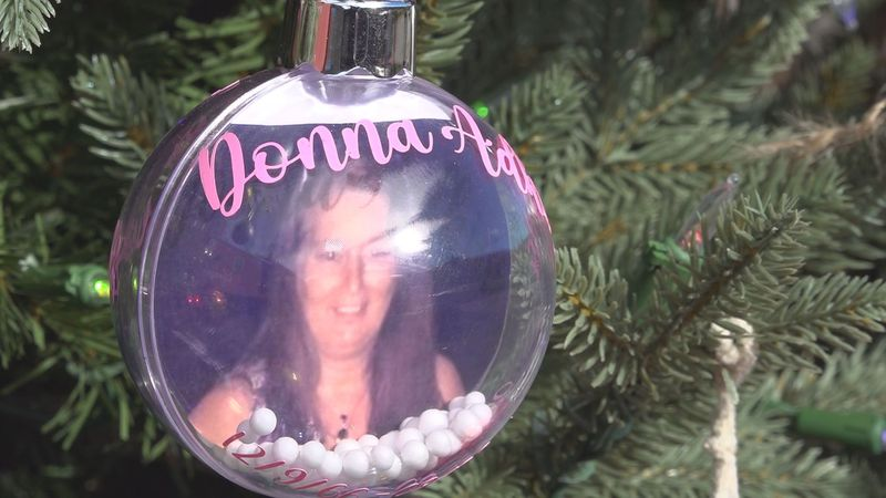 Ornaments dedicated in memory of beloved community members like Donna Adkins, who died this...