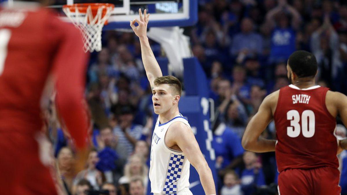 Kentucky's Nate Sestina, center, celebrates a made 3-point shot near Alabama's Galin Smith (30) during the first half of an NCAA college basketball game in Lexington, Ky., Saturday, Jan 11, 2020.