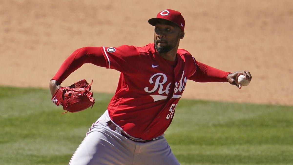 Cincinnati Reds relief pitcher Amir Garrett throws during a baseball game against the Los...
