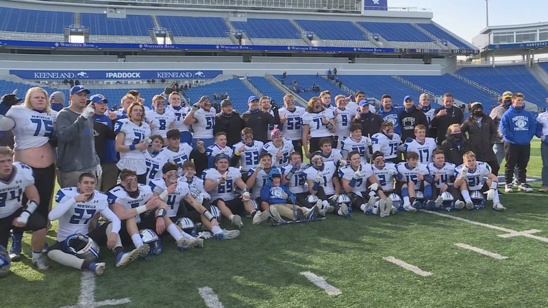 Paintsville poses after winning the school's first state football title with a 38-7 win over...