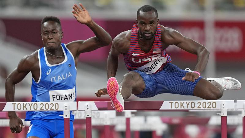 Daniel Roberts, of United States competes with Hassane Fofana, of Italy in a men's 110-meter...