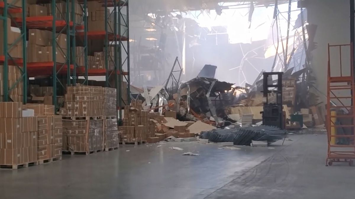 Cellphone photos and video from inside showed what appeared to be the tail of the plane buried in twisted metal and piles of cardboard boxes. (Source: Jeff Schoffstall/Facebook/CNN)