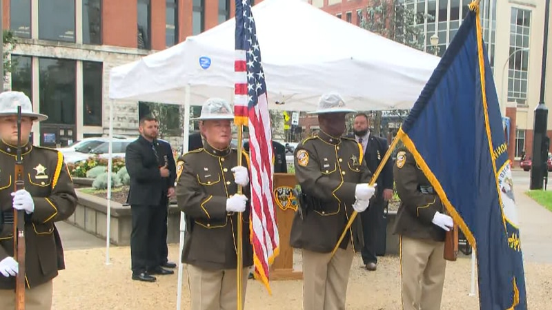 Two officers joining the memorial died from COVID-19 complications.