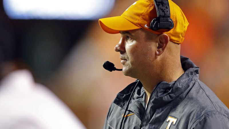 Tennessee head coach Jeremy Pruitt watches the first half of an NCAA college football game...