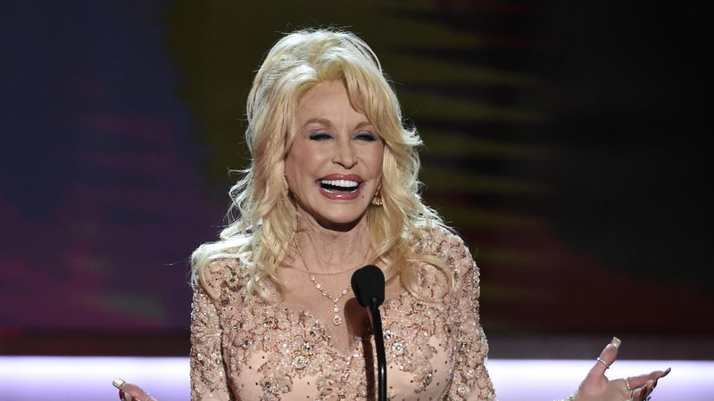 In this Jan. 29, 2017, file photo, Dolly Parton presents the Lifetime Achievement Award at the...