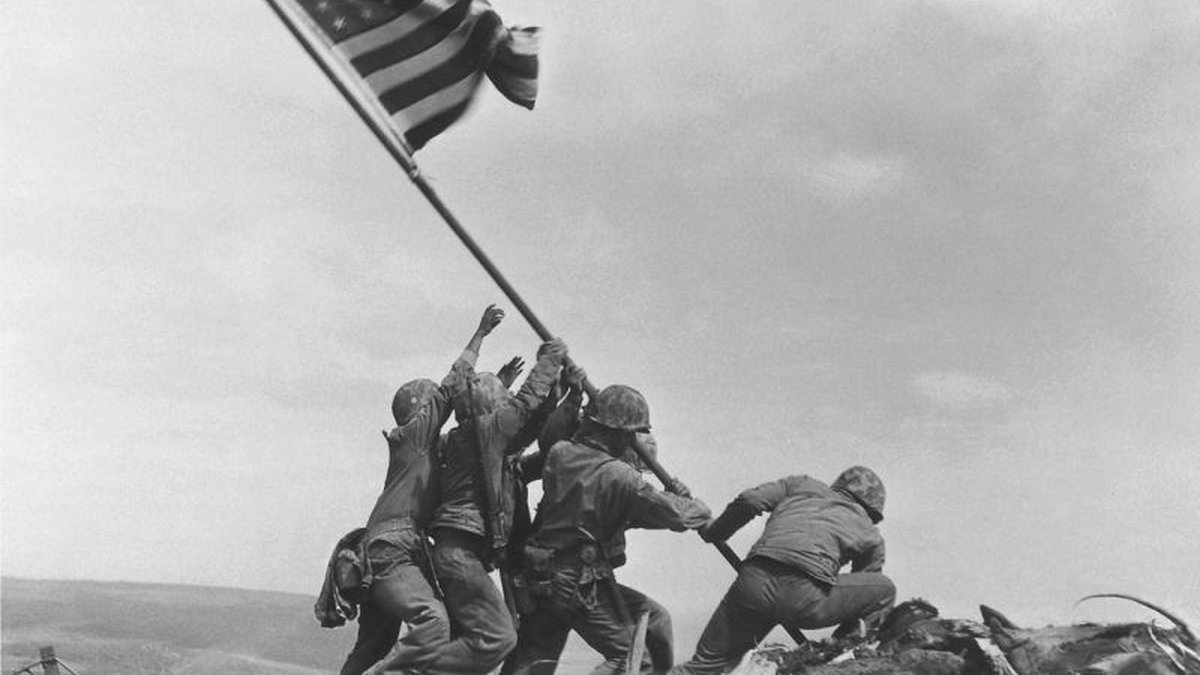 In this Feb 23, 1945 file photo, U.S. Marines of the 28th Regiment, 5th Division, raise the...