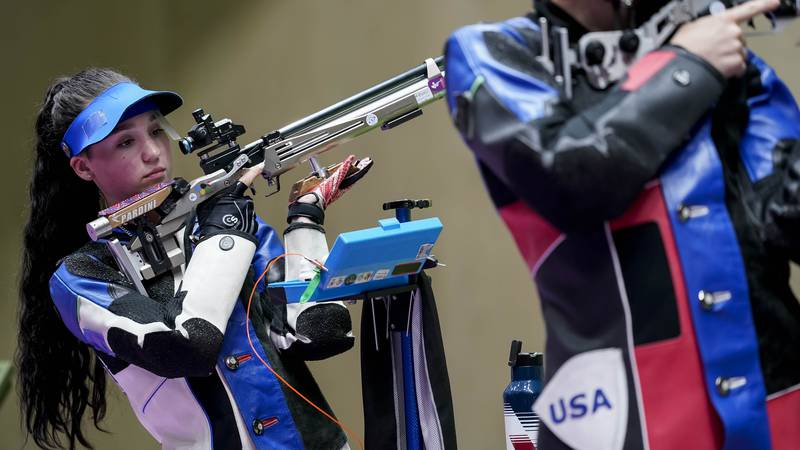 Mary Carolynn Tucker, left, and Lucas Kozeniesky, of the United States, compete in the mixed...
