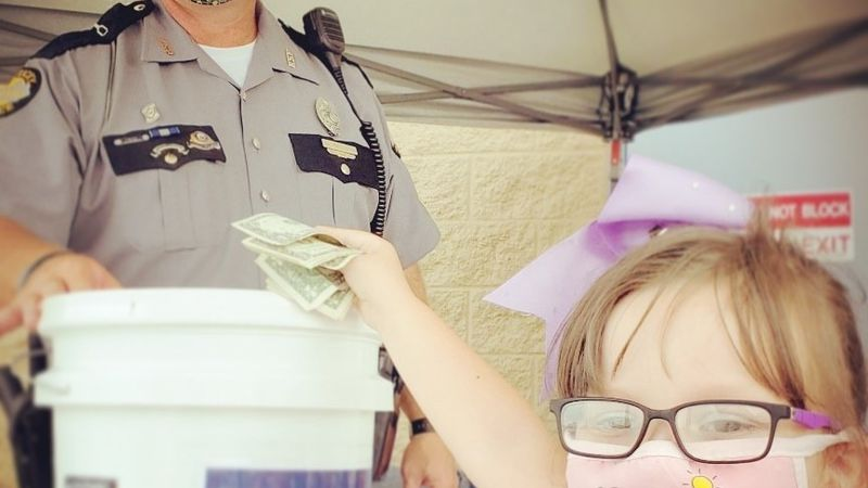 Trooper Scottie Pennington, KSP London Post accepting a donation from a young girl at the...
