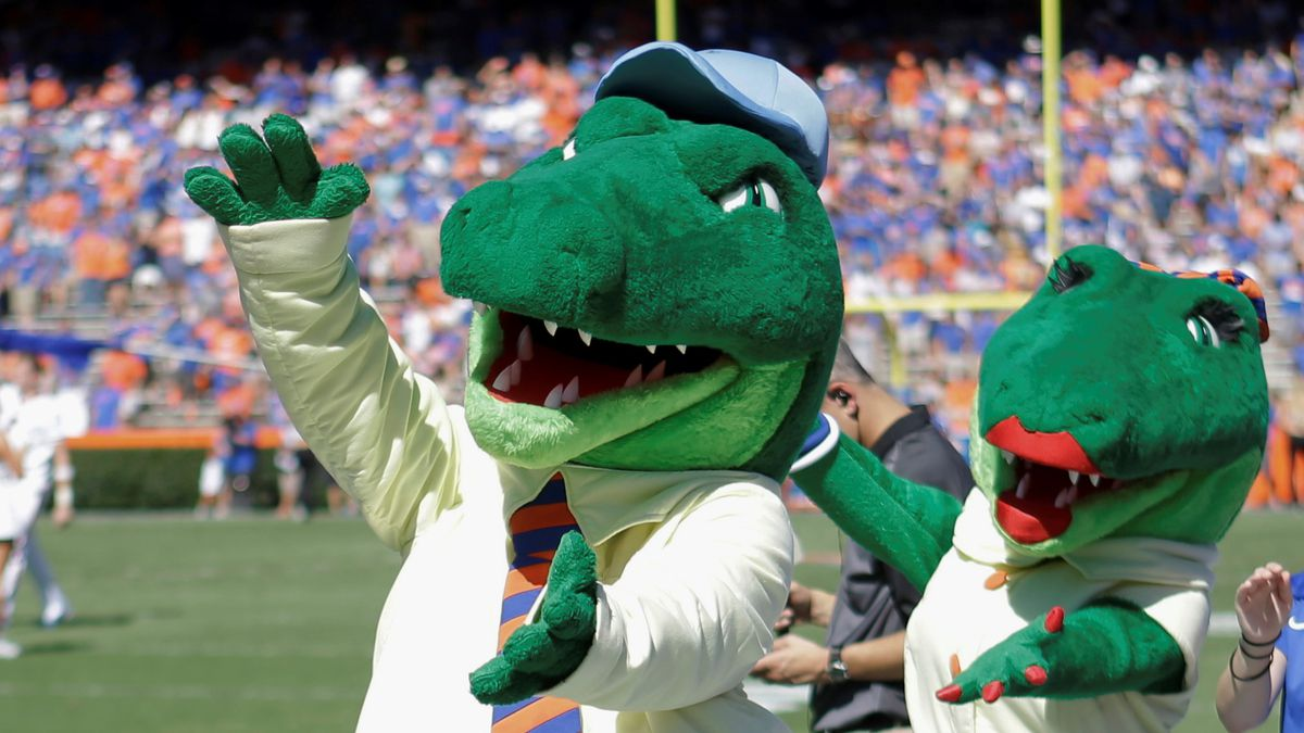 FILE - In this Nov. 7, 2015, file photo, Albert and Alberta, the mascots for Florida, do the gator chomp before the first half of an NCAA college football game against Vanderbilt in Gainesville, Fla. The University of Florida is ending its 'gator bait' cheer at football games and other sports events because of its racial connotations, the school's president announced Thursday, June 18, 2020, in a letter making several other similar changes on campus. (AP Photo/John Raoux, File)