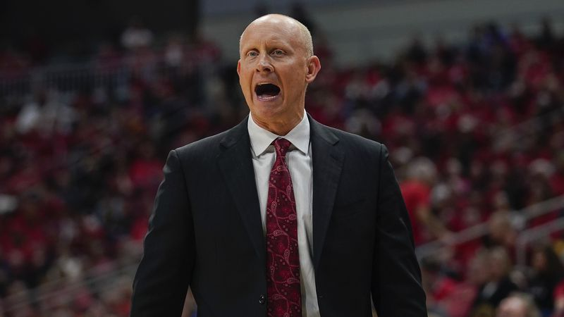 Louisville head coach Chris Mack reacts to a play during the second half of an NCAA college...