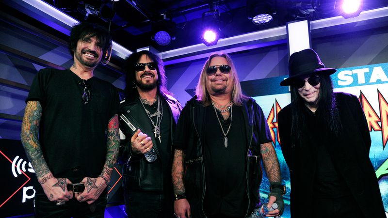 Tommy Lee, from left, Nikki Sixx, Vince Neil and Mick Mars of Motley Crue pose following a news...