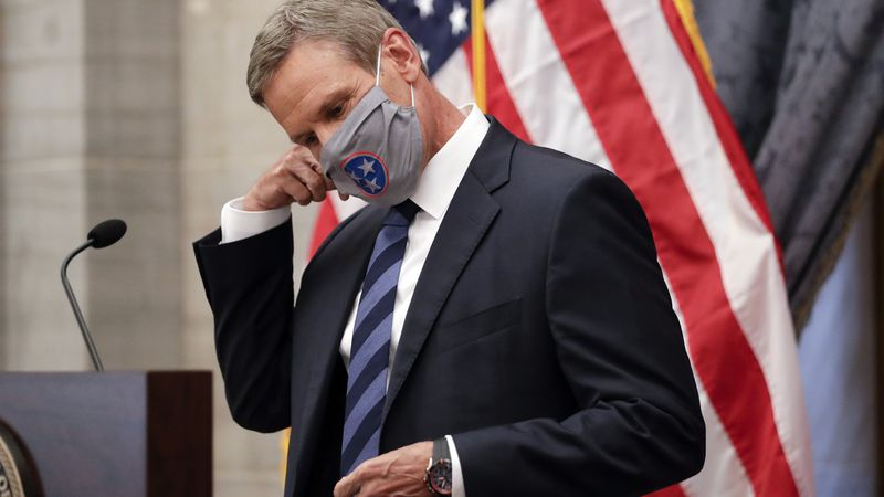 FILE - Tennessee Gov. Bill Lee removes his mask as he begins a news conference July 1, 2020, in...
