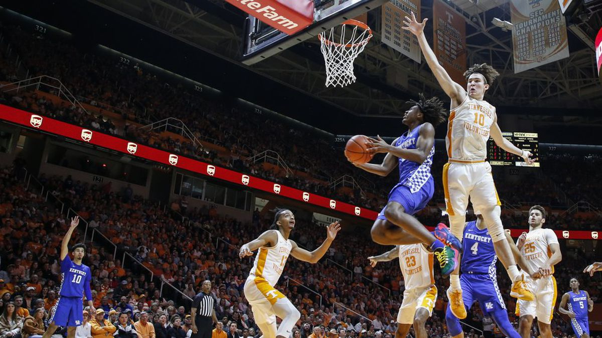 Kentucky guard Tyrese Maxey (3) shoots a reverse layup past Tennessee forward John Fulkerson (10) during the second half of an NCAA college basketball game Saturday, Feb. 8, 2020, in Knoxville, Tenn. Kentucky won 77-64. (AP Photo/Wade Payne)