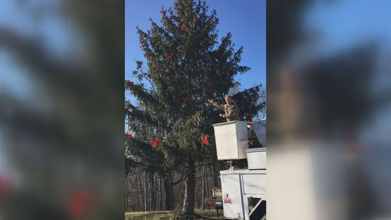 It took a good friend with a bucket truck to get the lights and decorations on the 50-foot...