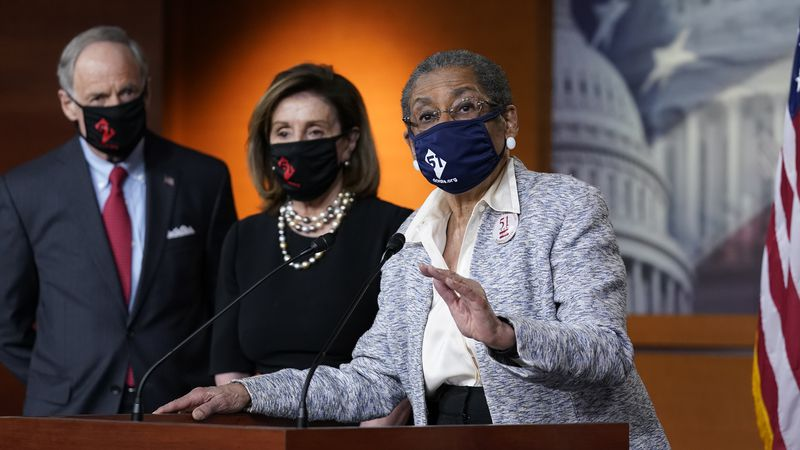In this April 21, 2021, photo, Del. Eleanor Holmes-Norton, D-D.C., center, joined from left by...