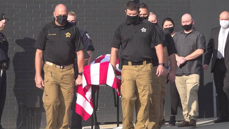 Local law enforcement gathered Friday to escort Oliver Little to the funeral home.